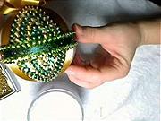Zlato-zelená vianočná guľa